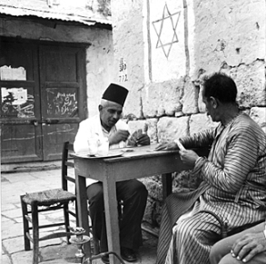 Playing cards in Majdal, before its depopulation in 1950. The Israeli city of Ashkelon now stands there. (George Pickow/Three Lions/Getty Images)