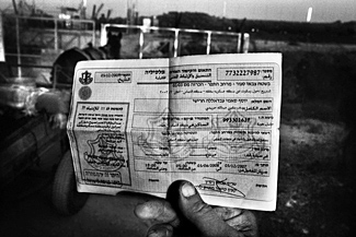 The Israeli permit for Palestinian farmers needing to pass through the separation barrier to reach their olive groves. (Reto Albertalli)
